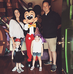 The Chiquet family celebrates Lily's third birthday at Disneyland, the day before she was diagnosed with leukemia. Courtesy photograph from Chiquet family