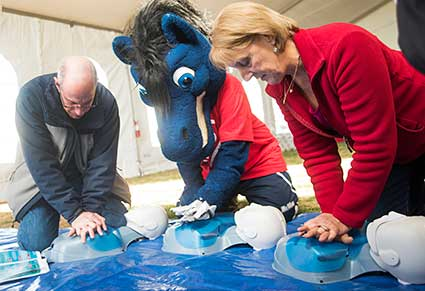 Photo of Gunrock joined Battle Heart Disease participants in learning CPR © UC Regents