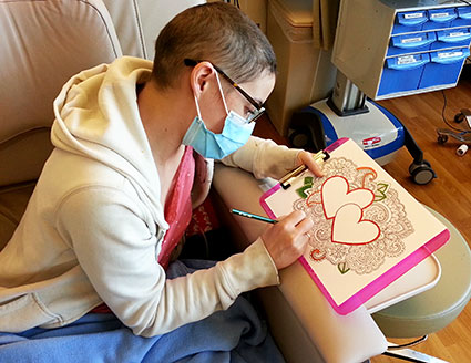 Leukemia patient Sandy Gantt colors to take her mind off chemotherapy. © UC Regents