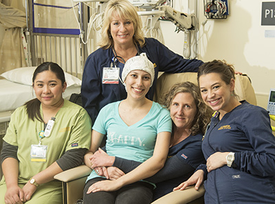 Leukemia patient Kristine Tesauro with her care team and good friends at the UC Davis Comprehensive Cancer Center.