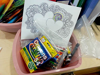 Patients are offered coloring supplies and pages from adult coloring books to help ease stress during