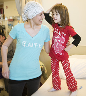 Pediatric cancer patient Paislee Schumann models her new T-shirt. © UC Regents
