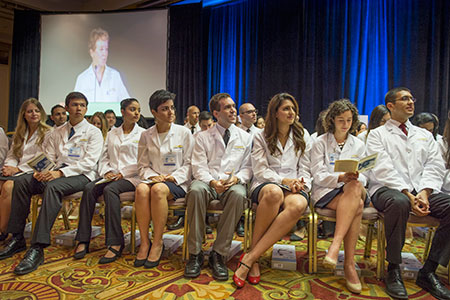 New students listen to Dr. Freischlag during ceremony. © UC Regents