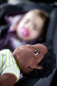 Photograph of sleeping child in car © iStockphoto