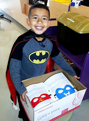 Cooper Cochran brings superhero capes and masks to pediactric cancer patients © UC Regents