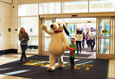 Snoopy enters UC Davis Medical Center to visit pediatric patients © UC Regents