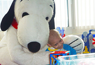 Snoopy gets a hug from patient © UC Regents