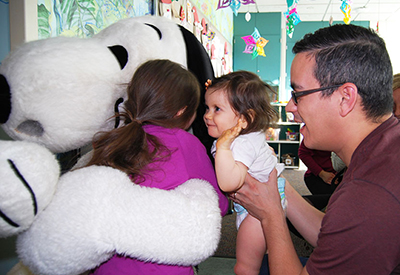 Snoopy gives big hugs to family © UC Regents