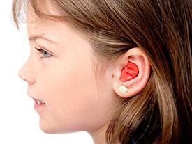 Girl with ear plugs