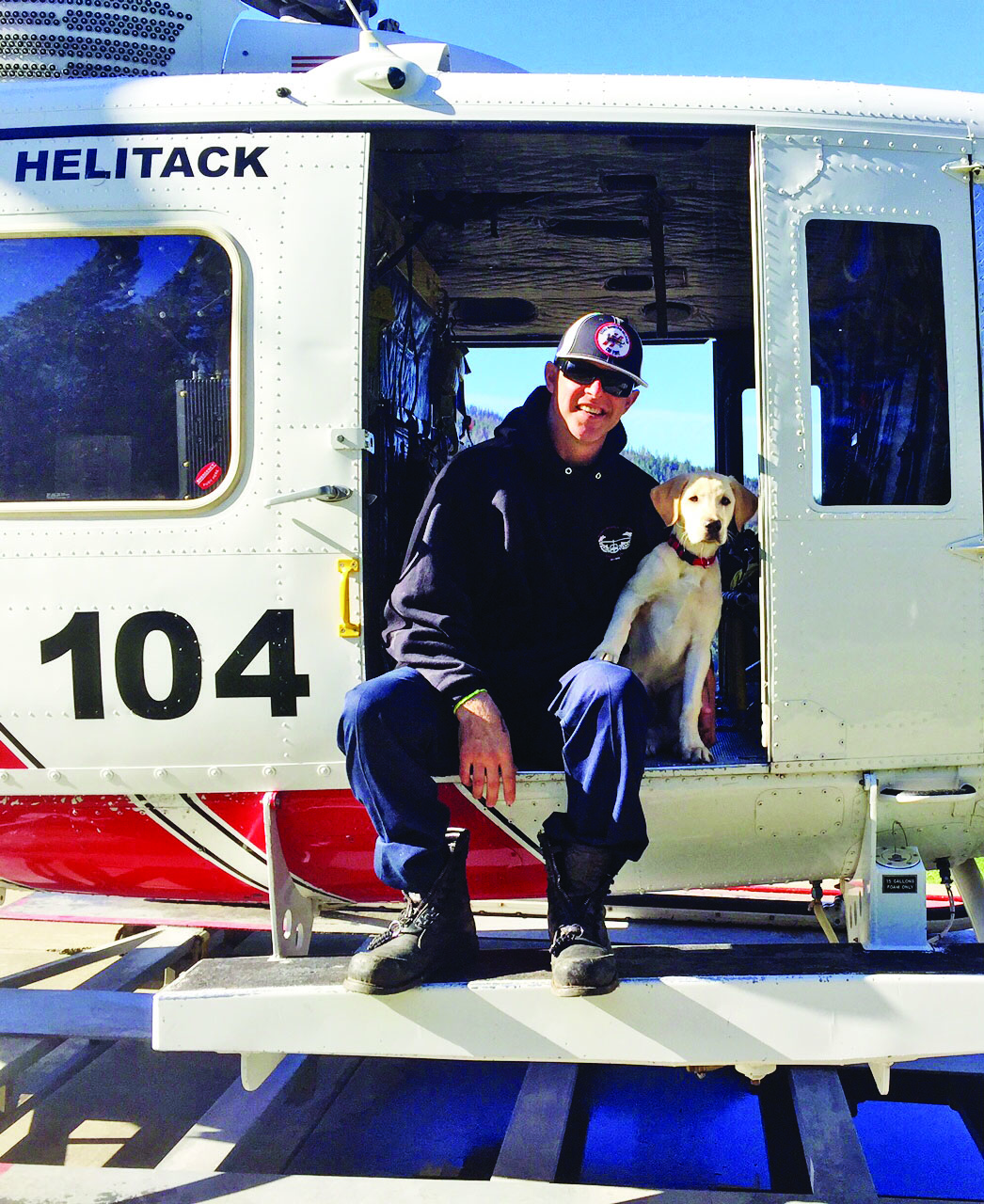 Firefighter Richard Reiff and his dog. Photo courtesy of the Reiff family