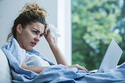 Woman in bed feeling ill