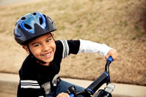 boy playing outside on bike