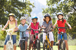 kids with bikes and helmets