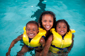 mom and kids in life jackets