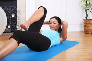 woman exercising on floor mat