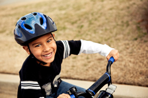 boy with helmet on bike