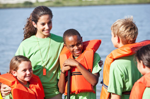 Kids with life jackets and adult supervision © iStockphoto