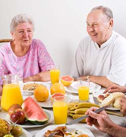 Photo of older adults enjoying a breakfast © iStockPhoto