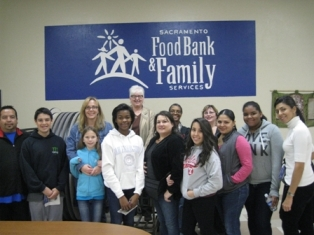 SOS employees volunteering their time at Sacramento Food Bank