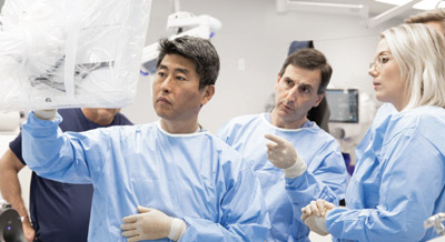 doctors using robotic surgery system