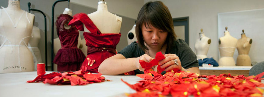 Designer creating a dress for the UC Davis Red Dress Collection