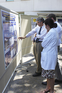 Dr. Henderson reviewing posters