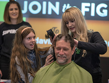 Scarlett Baily, one of the youngest attendees, learns how to give a close shave.
