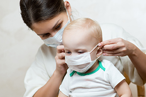 Face masks pose dangers for babies, toddlers during COVID-19 pandemic