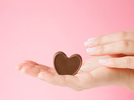 chocolate heart sitting in a hand