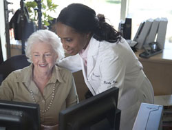 physician and patient at computer