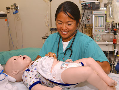 baby simulator and Dr. Emily Andrada