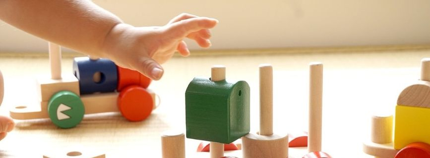 kid hand with blocks