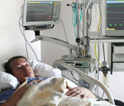 patient in hospital bed with monitors