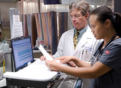 Dr. Nilas Young and nurse work to update record © UC Regents