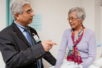 Dr. Vijay Khatri and patient © UC Regents