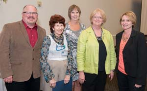 Nursing Ph.D. candidate Perry Gee, far left, and postdoctoral scholar alumni Dian Baker, second from right, were recognized by a Redding hospital.