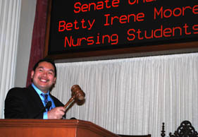 Master's-degree student Daniel Aquino in the California Senate chambers
