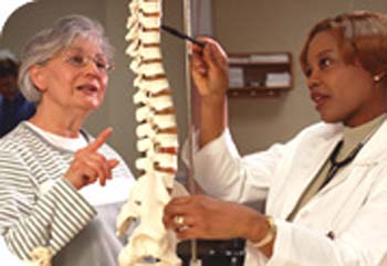 patient and doctor examining artificial spine