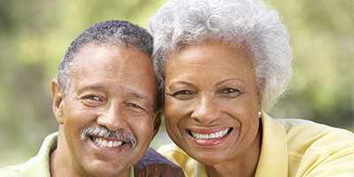 older black man and woman smiling