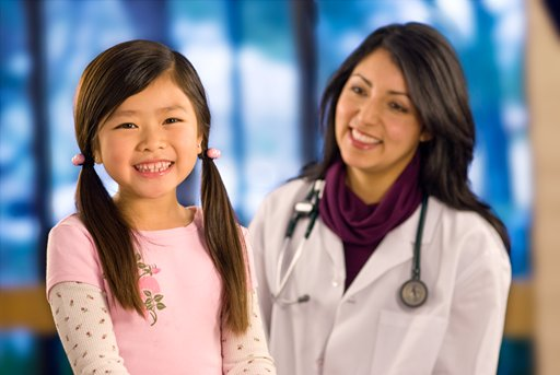 Doctor with young female patient (c) UC Regents