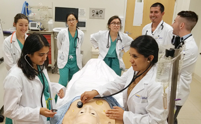 Medical students learning via a simulation mannequin. (C) UC Davis Regents.