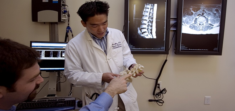 Doctor and patient discussing spine anatomy