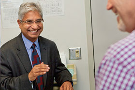 Surgical oncologist Vijay Khatri consults with a patient
