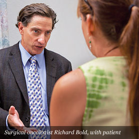 Surgical oncologist Richard Bold, with patient