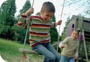 Photo of kids playing on swing