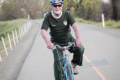 Terry Caldwell riding his bike near his home