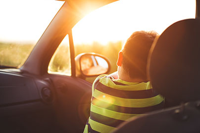 Young boy looking out car window