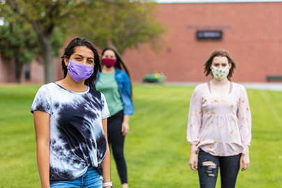 young women in masks, distanced