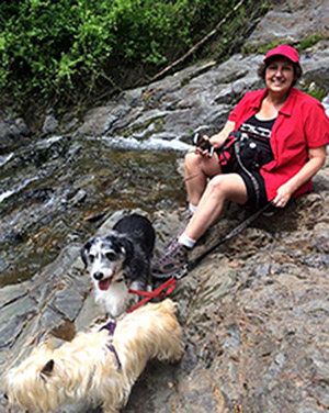 Nancy hiking with her dogs