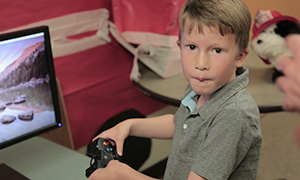 Caleb playing a video game